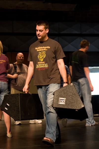 Josh Ascol hauling a couple monitors